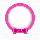Round Frame With Polka Dot Effect Paper With A Pink Ribbon.