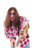 Man With Face Expression In Shirt Playing Electric Bass Guitar