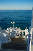 foto of balustrade  - Landmark Benidorm viewopoint whitawashed balustrades against the background of the ocean - JPG