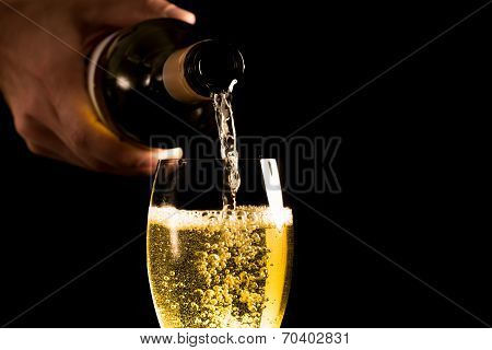 Pouring A White Wine Into A Glass
