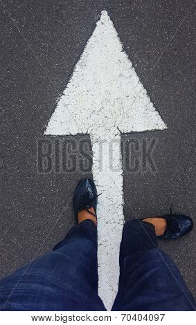 feet on tarmac road