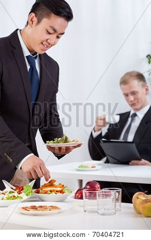Co-workers Eating Lunch During Meeting