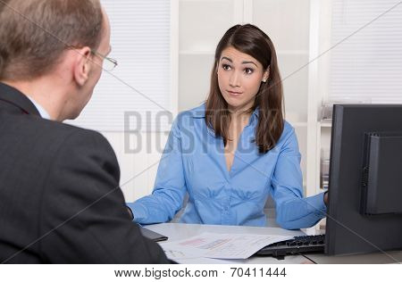 Client And Customer Sitting At Desk Or Communication Concept For Workplace Problems Under Colleagues