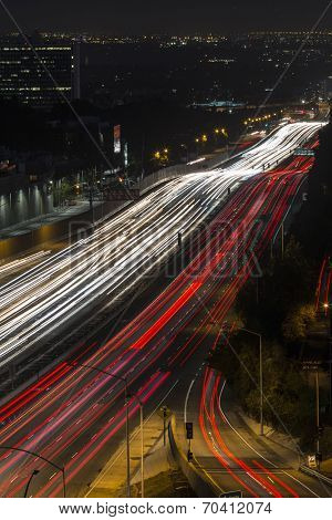 Fast night traffic on the San Diego 405 Freeway in west Los Angeles, California.