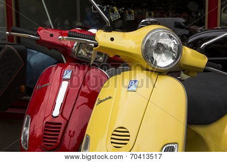 Yellow and Red Italian designed Vespa scooters