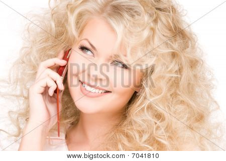 Happy Woman With Red Phone