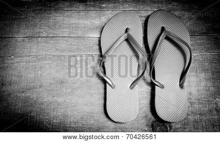 Wooden Background Flip-flops