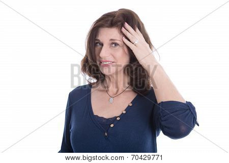 Doubtful And Pensive Mature Woman In Blue Isolated On White.