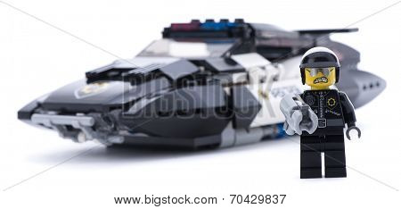 Ankara, Turkey - March 15, 2014 : Studio shot of bad police in front of flying police car isolated on white background.