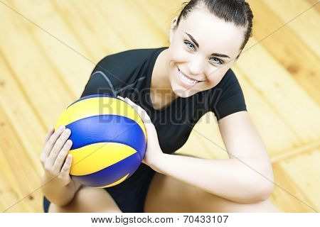 Sport Concept: Young Caucasian Volleyball Player Sitting On Floor With Ball