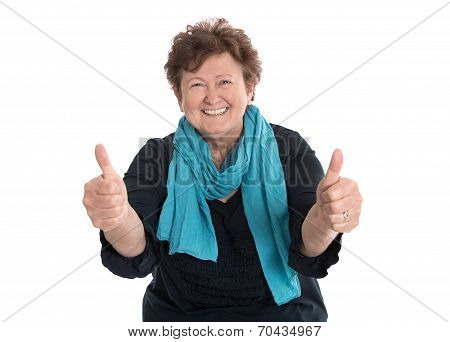 Enthusiastic And Happy Grandmother Making Thumbs Up Gesture With Two Fingers.