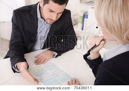 Adviser Sitting In A Meeting With A Blank On The Table Explaining Something.