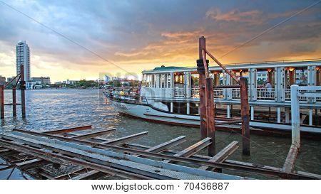 People Enjoy Dinner On Boat Tour