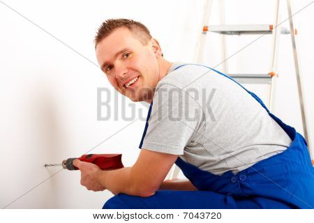 Man Drilling Hole
