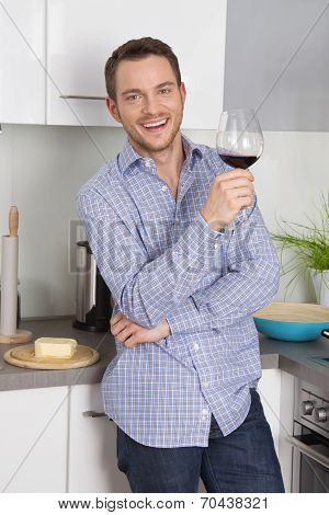 At The End Of Work: Single Man Drinking Glass Of Wine In The Kitchen.