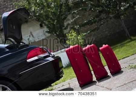 Suitcases In Front Of A Trunk
