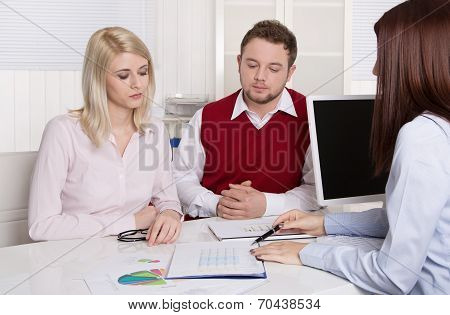 Financial Business Meeting: Young Married Couple - Adviser And Clients.