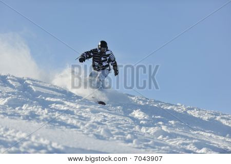 Freestyle Snowboarder Jump And Ride