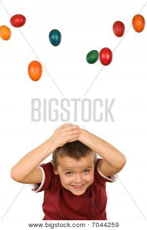 Boy With Falling Easter Eggs