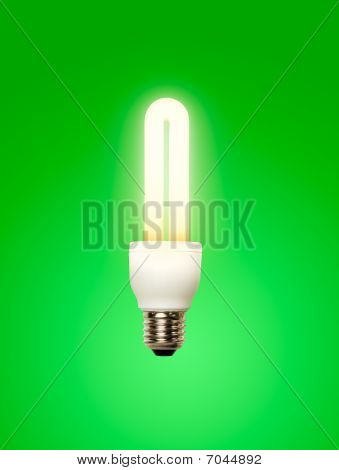 Energy saving lamp green background