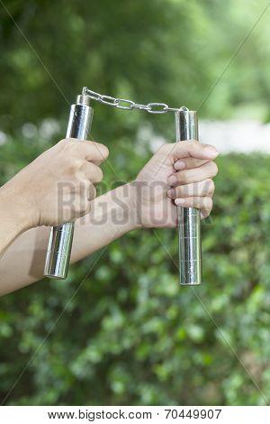 Holding a nunchaku