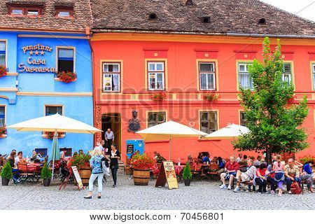 Unidentified tourists walking in historic town Sighisoara