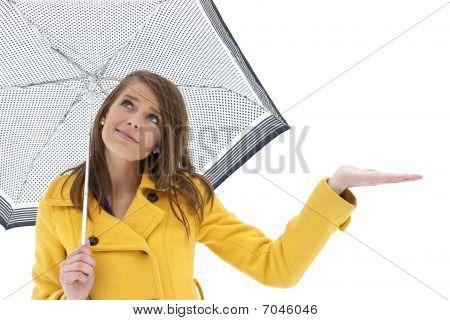 WOman under an umbrella looking for rain