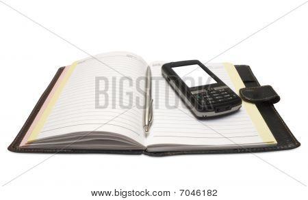 El mango y el teléfono móvil en Notebook