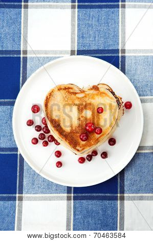 Love Heart Pancakes With Cranberries On Porcelain Plate. Closeup.
