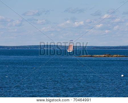 Four Masted Schooner In Blue Bay