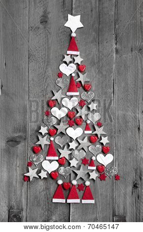 Christmas Tree Made Up Of Decoration On Grey Wooden Background
