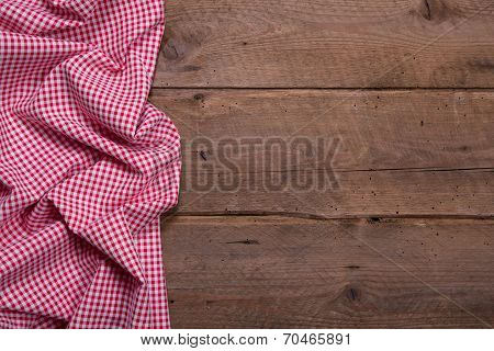 Checkered Fabric As Border On Wooden Background For Christmas Or For A Menue Card In A Restaurant Or