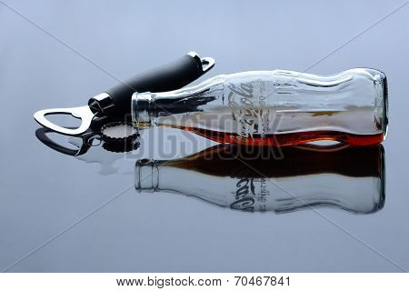 Bangkok, Thailand - September 1, 2012: Classic Bottle Of Coca-cola Lie Next To The Bottle Opener