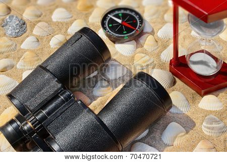 Vintage Binoculars, Compass,  Hourglass And Seashells. Marine Background.