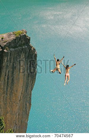 Two Cliff Jumping Girls, Against Turquoise Ocean