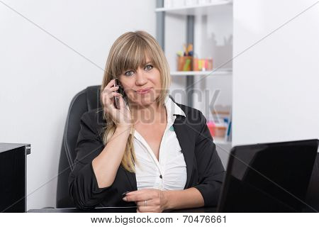 Woman Is Phoning At The Reception Counter