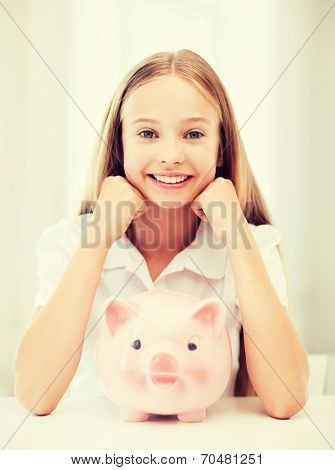 education, school and money saving concept - child with piggy bank