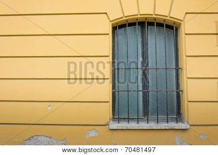 Wrought Iron Window Frame With Yellow Wall