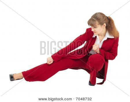 Woman In Red Business Suit Kicks