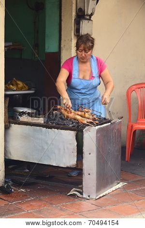 Roasting Guinea Pig in Banos, Ecuador
