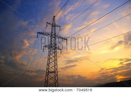 Sunset In Mountains And Electrified Track