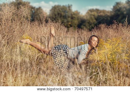 Girl Flying Over The Meadow