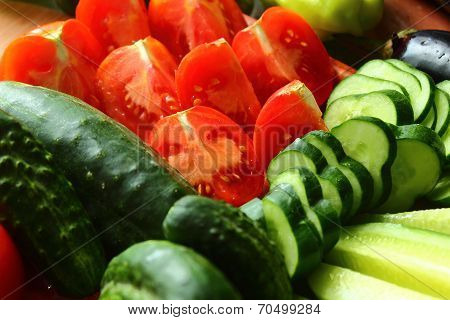 Sliced ??and Whole Tomatoes And Cucumbers