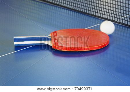Red Paddle, Tennis Ball On Blue Ping Pong Table