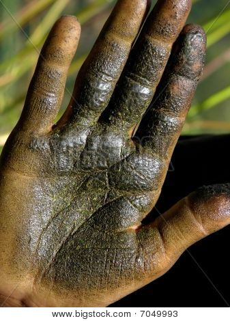 dirty open hand with hashish