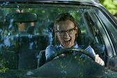 foto of independent woman  - Mad woman late for work in a car - JPG