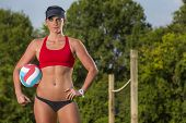 stock photo of volleyball  - A female beach volleyball athlete on the volleyball court - JPG