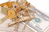 stock photo of cash  - conceptual image of the old jewelry on the money - JPG