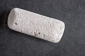 foto of pumice-stone  - Raw pumice stone on table light weight and with rough surface - JPG