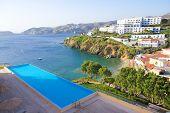 foto of infinity pool  - swimming pool with beautiful sea view in luxurious hotel in Greece - JPG